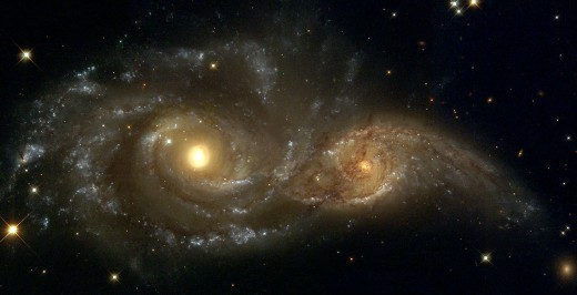 As imaged by the Hubble Space Telescope, the galaxies NGC2207 and IC2163 are in the process of colliding, some 80 million light years away.