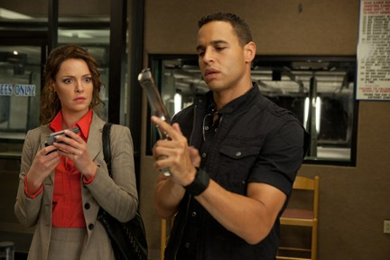 "Heigl learns how to hold a gun from Sunjata in ""One for the Money."""