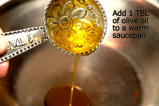 Warm a pan over medium heat and add 1 tablespoon of olive oil.