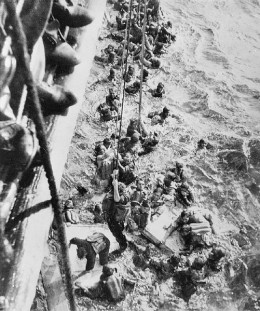 WWII: Survivors from the Bismarck are pulled aboard HMS Dorsetshire on 27 May 1941.