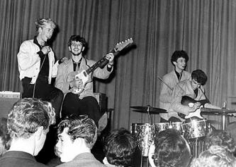 Yes, Ringo is playing guitar!