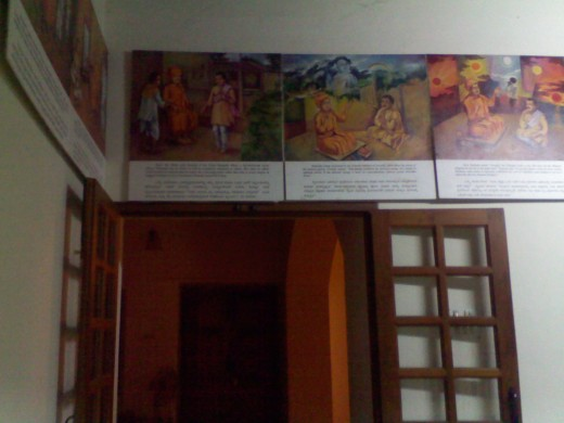 The door between verandah and inner hall of the house. The paintings seen here are kept on all four sides, after converting it into a memorial.Behind this door is the hall where now the statue of Swamiji is kept.