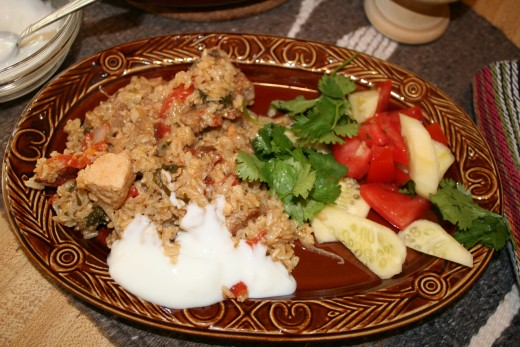 Finished Yummy Biryani with yogurt, cucumbers and fresh tomatoes