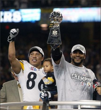 'Jerome Bettis hoists the Lombardi Trophy in triumph beside Hines Ward after Superbowl XL.'