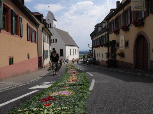 A flower carpet going right through the village.