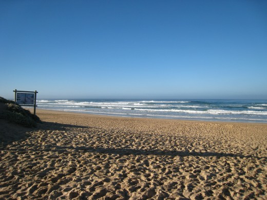 Atlantic Ocean washing onto the beach at the Wilderness - Eastern Cape.