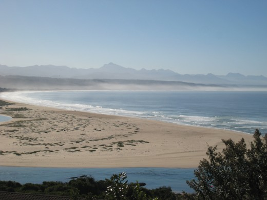 Breathtaking beauty of Plettenberg Bay with  the Outeniqua mountains in the distance.
