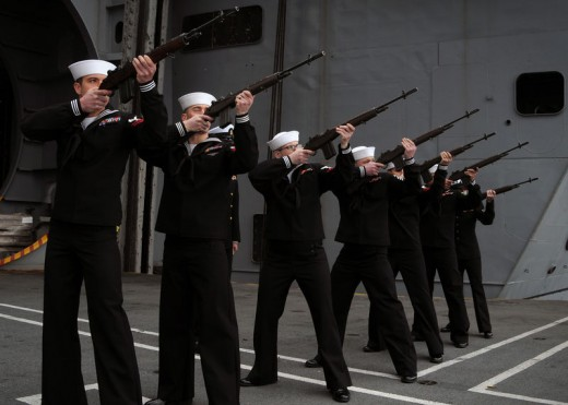 The 3-volley salute is a ceremonial act performed at military and police funerals as part of the drill and ceremony of the Honor Guard.  It consists of a rifle party firing blank cartridges into the air three times