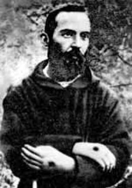 A young St. Padre Pio † bearing the stigmata.