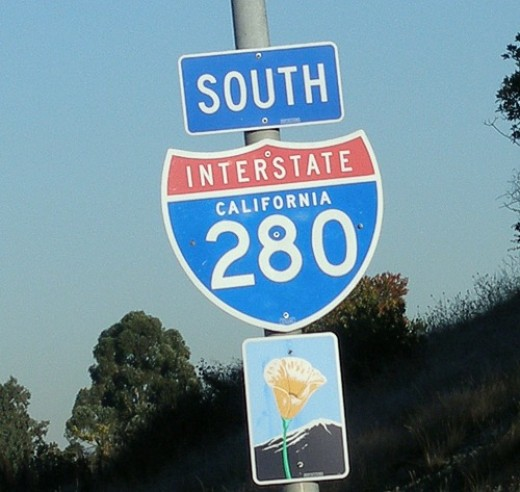 280 sign that also shows the Poppy Sign underneath, indicating that this is a state Scenic Highway.
