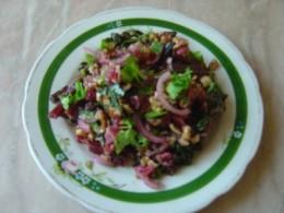 Add onion, garlic, greens walnuts, vegetable oil, lemon juice.