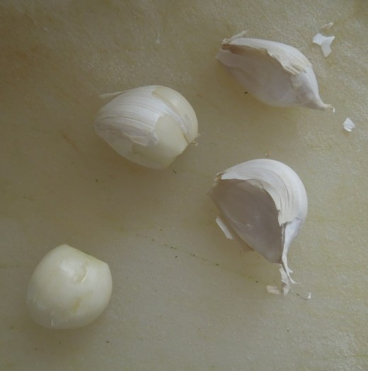 Garlic cloves are separated and ready to peel.