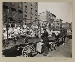Title: Traveling Tin Shop Date: May 22, 1936 Comments: The location of the photograph is unknown but the neighborhood resembles Talman and Jay Streets in the Fort Greene area of Brooklyn, which Abbott photographed on the same day.