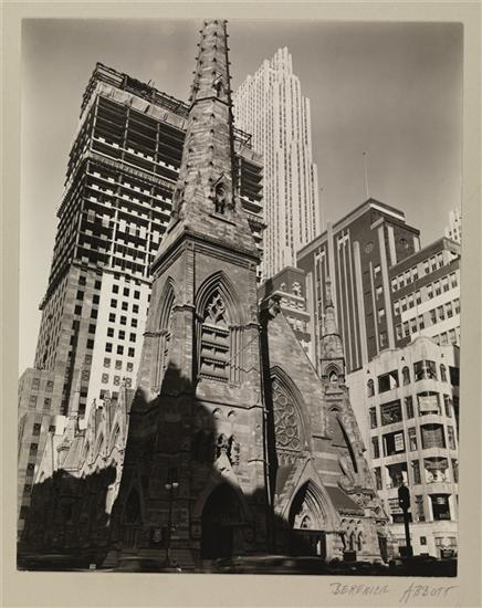 Title: Rockefeller Center with Collegiate Church of St. Nicholas Date: December 8, 1936 Comments: The Collegiate Church of St. Nicholas at Fifth Avenue and 48th Street, with the Time & Life Building under construction behind it and the tall tower of