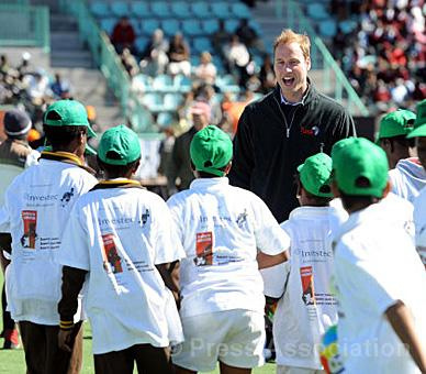 WILLIAM TALKING TO YOUNG ATHLETES.