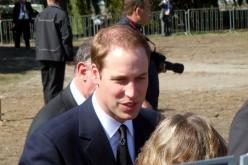 WILLIAM SMILING AT CROWDS.