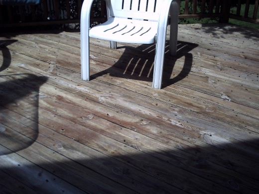 Now it has been powerwashed... but some small patches of old stain did not come off under where the table was and on the stairs