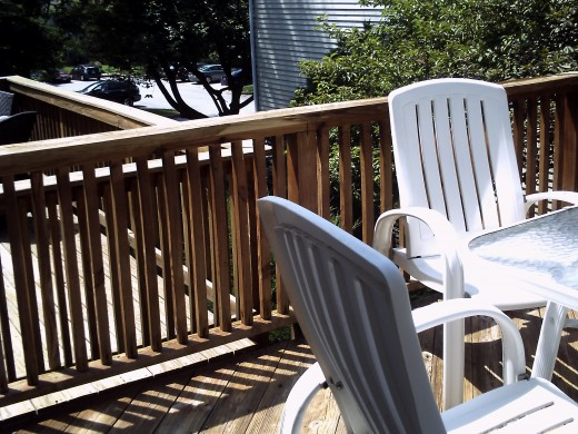The spindles and rail top are getting old.  We are going to use a solid cedar stain and of course, nails tightened