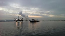 Looking inland from the South Gare with the Tees Bay Wind Farm
