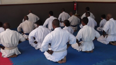 Kyokushin karate students in Papua New Guinea in Mokuso (meditation).