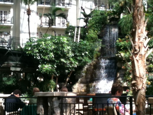 The waterfall's sounds provide a soothing background as you meander the hotel's walkways or dine in an outdoor restaurant.