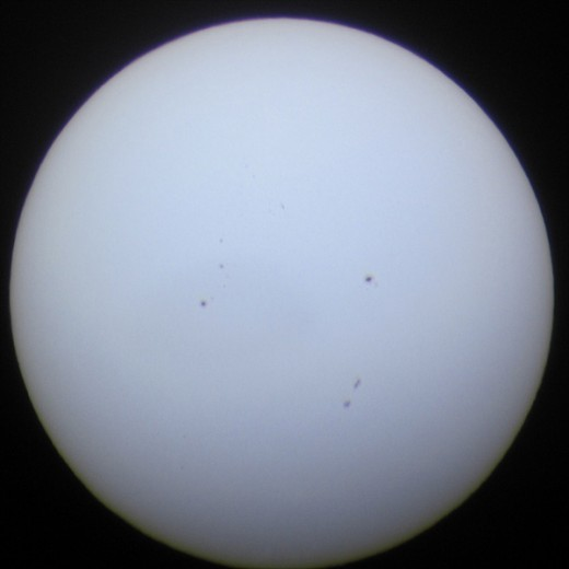 "The sun pre-transit: 2:42 PM. Testing the rig. That's a lot of sunspots! The sun's activity waxes and wanes in an 11-year cycle, and ""solar max"" (maximum flares/sunspots"" is in 2013."