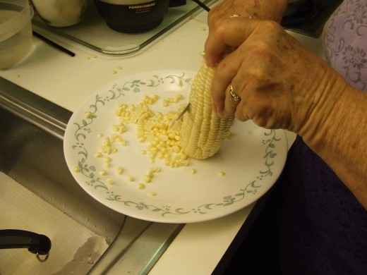With a sharp knife take the kernels off the cobs.
