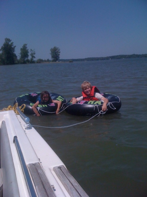 Kids float on tubes near the beach at Alum Creek State Park