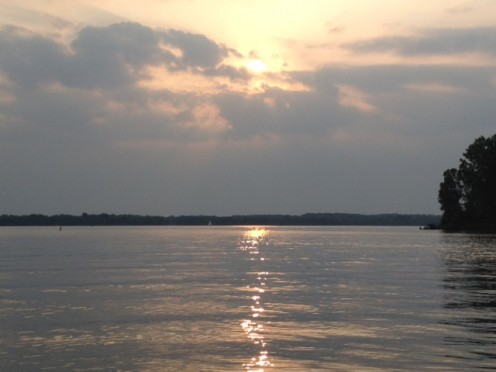 Clouds and sun in the western sky reflect off Alum Creek Reservoir.