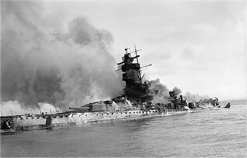 The German battleship ADMIRAL GRAF SPEE in flames after being scuttled in the River Plate estuary off Montevideo, Uruguay, December 17, 1939