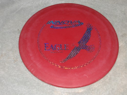 A Driver disc like this, along with a putter are sufficient for most beginners.