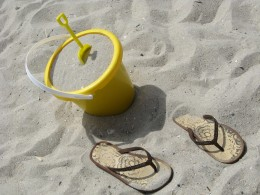 Wearing flip flops on the beach keeps feet cool from the hot sand.