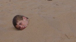 Its always fun to bury your brother in sand at the beach.