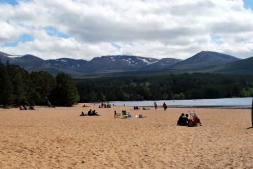 The beach at Loch Morlich is a great place to play in the sand