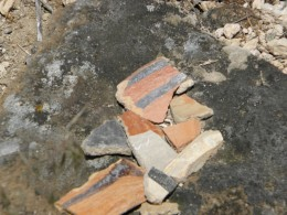 Broken pieces of pottery in the New Mexico desert ......