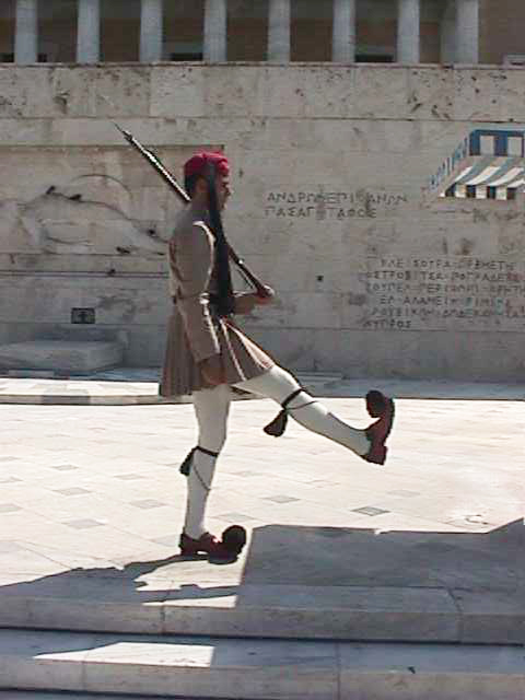 An evzone (soldier) in front of the Tomb of the Unknown Solder, at the base of the Parliament Building in Syntagma Square.