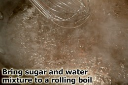 Bring sugar and water to a boil while stirring to make a clear syrup.