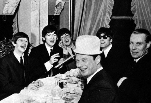 The Beatles with Brian (hat) and George Martin in 1964.