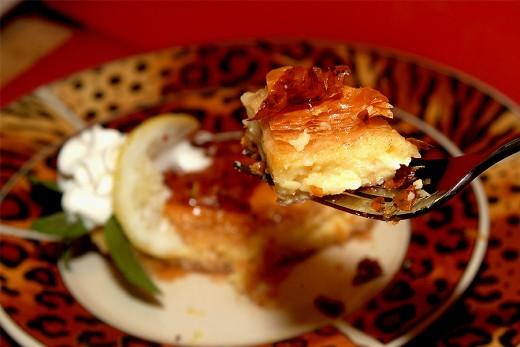 Serve chilled with lemon zest, mint sprig, and a lemon wedge for garnish.