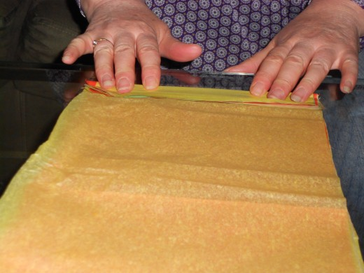 Flatten tissue and begin to fold  accordian or fan style.  Make folds 1 to 1.5 wide