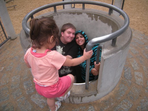 Some playgrounds have manholes to climb down.