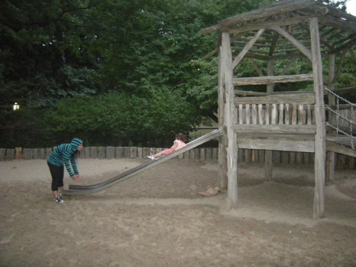 Some playgrounds have wooden slides and play scapes.