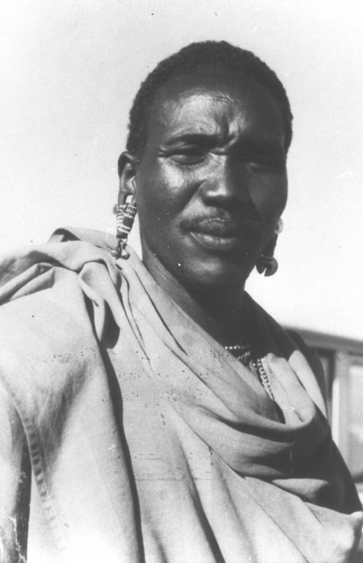A dignified Massai tribesman photographed in 1986.  They are gentle, pastoral people, occupying Tanzania and Kenya.