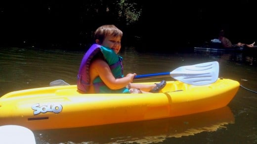 Our son sporting his life jacket on the kayak.