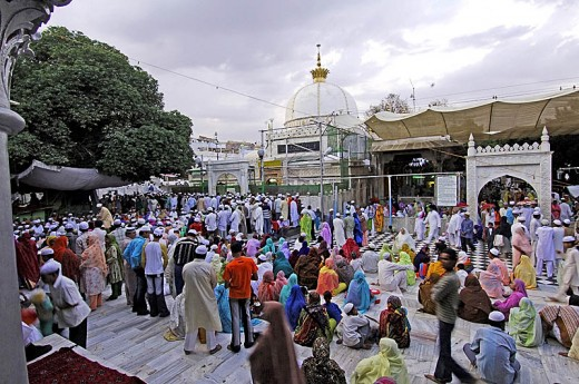 The Above Picture shows Ajmer Sharif - A famous Shrine in India, Although Azan is heard it is mostly ignored as their rituals will always continue.