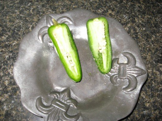 Cut jalapenos in half and remove seeds and ribs.