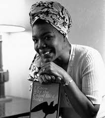 "Angelou with her book ""I Know Why the Caged Bird Sings"""