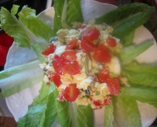 Egg salad and tomatoes on lettuce