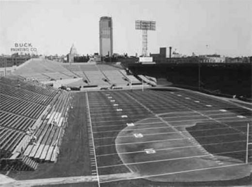 Fenway Park as it appeared set up for a Patriots game in the mid 1960s. Notice the  temporary stands in left field and the uncompleted Prudential tower in the background