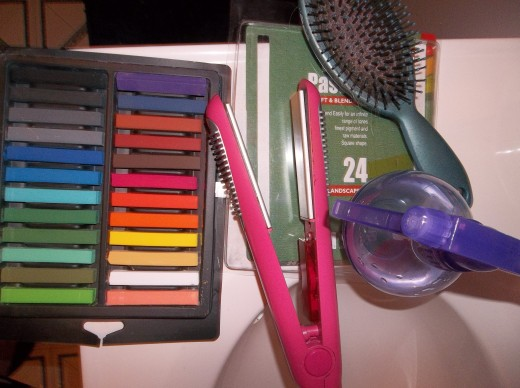 The tools needed. Hair straightener, pastel chalk, brush, and a spray bottle.